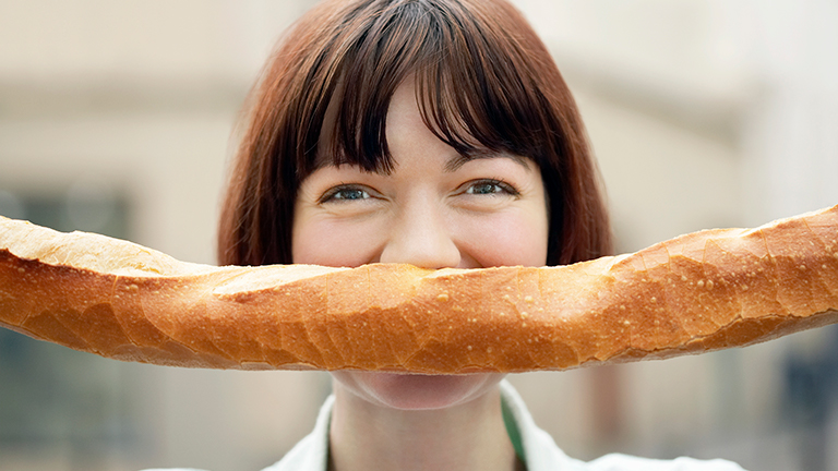 A French lady with a bread mustache